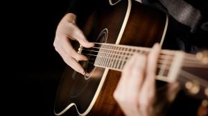 Playing-Acoustic-Guitar-Wallpaper